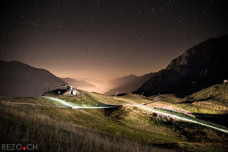 "Col Chercrouit, Italy - 08/31/2013: Rory Bosio, running toward the valley after crossing Pass Chercrouit. Lit by their headlamps, runners continue the race toward Courmayeur, Italy after a short halt at Shelter ""Maison Vieille"" (old house) (1956m high) where they've been able to drink and eat. Credit: Niels Ackermann / Rezo.ch"