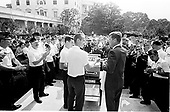Washington, DC - (FILE) -- American Legion Boy's Nation visits United States President John F. Kennedy in the Rose Garden on July 26, 1963.  Among the faces in the crowd are Helen Thomas near center left and 16 year old Bill Clinton near center right.  Within minutes, Clinton was to shake Kennedy's hand..Credit: Arnie Sachs / CNP