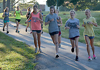 Graham Thomas/Siloam Sunday<br /> Members of the Siloam Springs cross country team run along the bike trails on the campus of John Brown University during cross country practice on Wednesday morning.