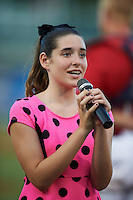 Talia Tumminello sings the national anthem before a Fort Myers Miracle game against the Daytona Tortugas on June 17, 2015 at Hammond Stadium in Fort Myers, Florida.  Fort Myers defeated Daytona 9-5.  (Mike Janes/Four Seam Images)