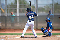 Milwaukee Brewers outfielder Anderson Melendez (94) at bat in front of catcher Ramon Rodriguez (55) during an Instructional League game against the Los Angeles Dodgers at Maryvale Baseball Park on September 24, 2018 in Phoenix, Arizona. (Zachary Lucy/Four Seam Images)