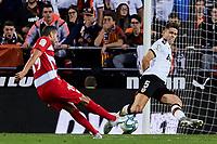 9th November 2019; Mestalla, Valencia, Spain; La Liga Football,Valencia versus Granada; Angel Montero of Granada shoots challenged by Garbiel Paulista of Valencia CF - Editorial Use