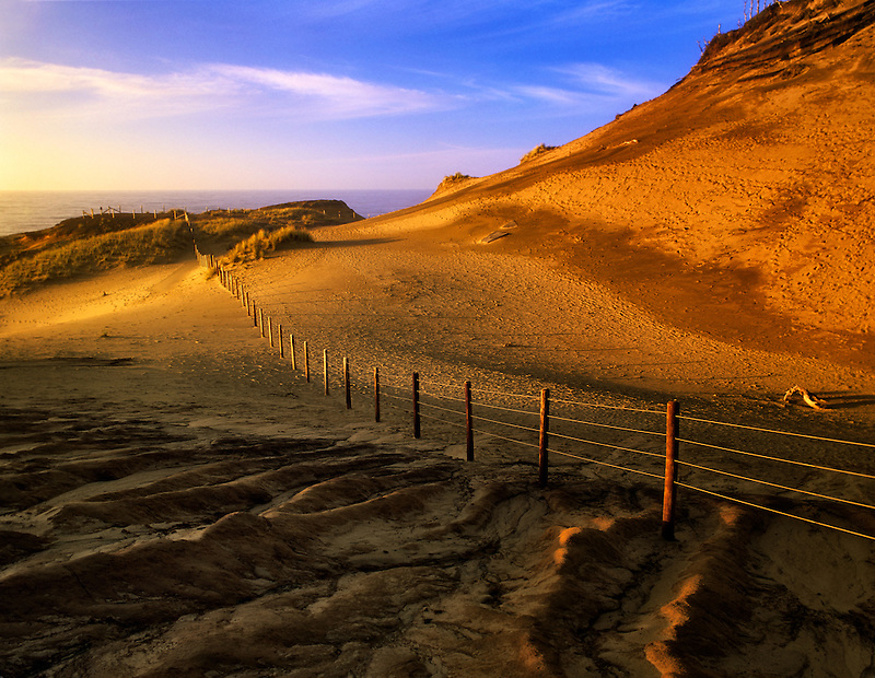 Fence line and ocean at Cape Kiwanda, Oregon