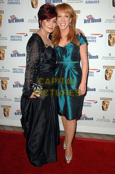 SHARON OSBOURNE & KATHY GRIFFIN.Los Angeles BritWeek 2009 culminates with BAFTA/LA second annual British Comedy held at The Four Season Hotel, Beverly Hills, California, USA..May 8th, 2009.full length black dress silk satin sheer green teal hand in pocket clutch bag .CAP/ADM/KB.©Kevan Brooks/AdMedia/Capital Pictures.