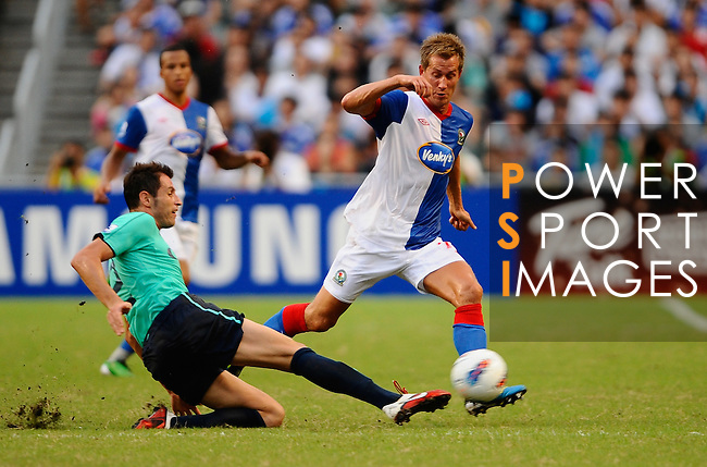 SO KON PO, HONG KONG - JULY 30: Morten Gamst Pedersen of Blackburn Rovers and Fernando Recio Comi of Kitchee in action during the Asia Trophy pre-season friendly match at the Hong Kong Stadium on July 30, 2011 in So Kon Po, Hong Kong.  Photo by Victor Fraile / The Power of Sport Images