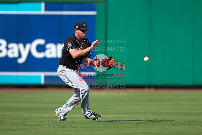 Jupiter Hammerheads outfielder Austin Dean (3) fields a ball during the first game of a doubleheader against the Clearwater Threshers on July 25, 2015 at Bright House Field in Clearwater, Florida.  Jupiter defeated Clearwater 8-5.  (Mike Janes/Four Seam Images)