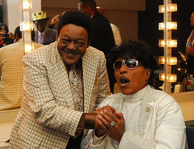 "Legendary musicians Antoine Dominque ""Fats Domino"" and Little Richard share a few memories in Little Richards dressing room after he performed in New Orleans Saturday May 30,2009 as part of the Domino Effect Benefit concert which also featured B.B. King and Chuck Berry. Domino Effect Benefit Concert legendary performers gather in New Orleans at the Arena to raise funds and awarness for hurricane Katrina rebuilding for Fats Domino the Tipatina Foundation and the Drew Brees' foundation. Photo©Suzi Altman ALL IMAGES ©SUZI ALTMAN. IMAGES ARE NOT PUBLIC DOMAIN. CALL OR EMAIL FOR LICENSE, USE, OR TO PURCHASE PRINTS 601-668-9611 OR EMAIL SUZISNAPS@AOL.COMPhoto©Suzi Altman"