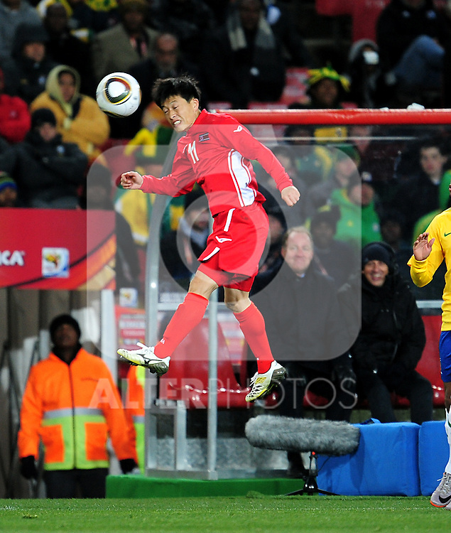 11 MUN In Guk  heads the ball during the 2010 FIFA World Cup South Africa Group G match between Brazil and North Korea at Ellis Park Stadium on June 15, 2010 in Johannesburg, South Africa.