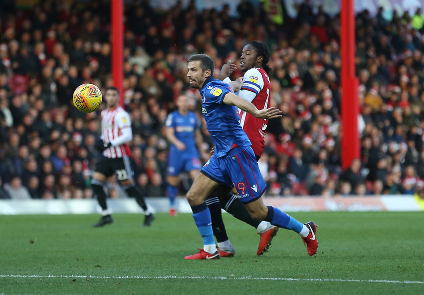 Bolton Wanderers' Gary O'Neil and Brentford's Romaine Sawyers<br /> <br /> Photographer Rob Newell/CameraSport<br /> <br /> The EFL Sky Bet Championship - Brentford v Bolton Wanderers - Saturday 22nd December 2018 - Griffin Park - Brentford<br /> <br /> World Copyright © 2018 CameraSport. All rights reserved. 43 Linden Ave. Countesthorpe. Leicester. England. LE8 5PG - Tel: +44 (0) 116 277 4147 - admin@camerasport.com - www.camerasport.com
