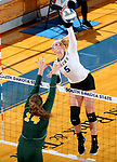 BROOKINGS, SD - SEPTEMBER 24: Hanna Jellema #5 from South Dakota State looks to get a kill past Erika Gelzinyte #14 from North Dakota State during their match Sunday evening at Frost Arena in Brookings. (Photo by Dave Eggen/Inertia)