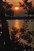 The sun sets on the James River in Virginia.