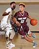 Darien Jenkins #12 of Deer Park, right, gets pressured by Taj Thorpe #5 of Baldwin during the penultimate game in the Tip of the Hat Classic at Adelphi University on Sunday, Jan. 10, 2016.