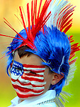 Alex Staley, 7, of East Hartford, with his face and head covered in red white and blue,  prior to the ten annual  Push, Pedal, Pull Patriotic Parade in downtown Rockville, part of the Vernon's July in the Sky celebration, Thursday, June 30, 2011. (Jim Michaud/Journal Inquirer)