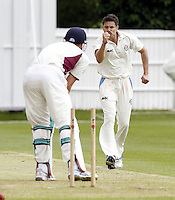 Zak Khan (R) of Hampstead celebrates after bowling Nick Brand during the ECB Middlesex Premier League game between North Middlesex and Hampstead at Park Road, Crouch End on Saturday May 17, 2014