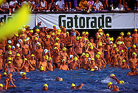 Dozens of men get ready for the swim event at the annual Ironman Triatholon on the Big Island of Hawaii.