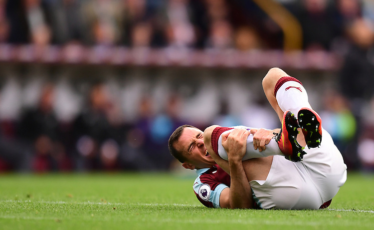 Burnley's Dean Marney holds his right leg after a challenge<br /> <br /> Photographer Chris Vaughan/CameraSport<br /> <br /> Football - The Premier League - Burnley v Swansea City - Saturday 13th August 2016 - Turf Moor - Burnley<br /> <br /> World Copyright &copy; 2016 CameraSport. All rights reserved. 43 Linden Ave. Countesthorpe. Leicester. England. LE8 5PG - Tel: +44 (0) 116 277 4147 - admin@camerasport.com - www.camerasport.com