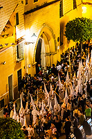High angle view of hooded penitents (Nazarenos) in the procession of the Brotherhood (Hermandad) La Candelaria, Holy Week (Semana Santa), Seville, Andalusia, Spain.