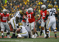 Ohio State Buckeyes defensive lineman Robert Landers (67) celebrates a sack of Michigan Wolverines quarterback Shea Patterson (2) during the second quarter of the NCAA football game at Ohio Stadium in Columbus on Nov. 24, 2018. [Adam Cairns/Dispatch]