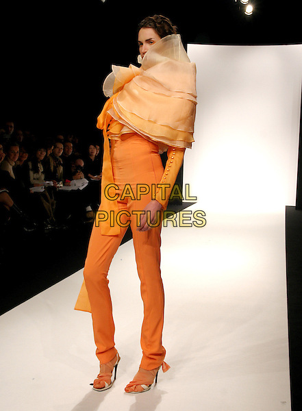 MODEL.Erin Setherston's Spring/ Summer Haute Couture Collection 2005 Fashion Show, Paris, .January 24th 2005..full length orange trousers suit ruffle cloak cape catwalk.**UK SALES ONLY**.Ref: MDS.www.capitalpictures.com.sales@capitalpictures.com.©Virgille Biechy/O.Medias/Capital Pictures .