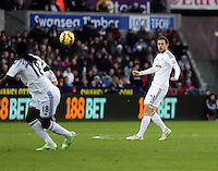 Pictured: Gylfi Sugurdsson of Swansea (R) passing the ball to team mate Bafetimbi Gomis (L) Saturday 10 January 2015<br />