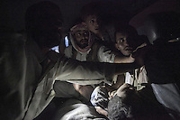 July 15, 2015 - Sa'dah, Yemen: The younger brother of Bashar Al Asadi (not pictured), is driven to the local hospital as he struggles for his life inside an ambulance after was rescued from the rubble of a house building hit by a fighter jet from the Saudi-led coalition in the northern city of Sa'dah, the stronghold of the Houthi movement in Yemen. The family of Bashar was buried under the rubble during the attack. Two members of his family, the mother (not pictured) and his brother died from their injuries, while his sister (not pictured) survived. (Photo/Narciso Contreras)