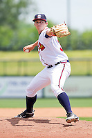 Relief pitcher Kyle Mertins #33 of the Rome Braves in action against the Hagerstown Suns at State Mutual Stadium on May 2, 2011 in Rome, Georgia.   Photo by Brian Westerholt / Four Seam Images