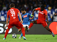 5th November 2019; Stadio San Paolo, Naples, Campania, Italy; UEFA Champions League Group Stage Football, Napoli versus Red Bull Salzburg;  Lorenzo Insigne of Napoli shoots as he is challenged by Jerome Onguene of Salzburg  - Editorial Use