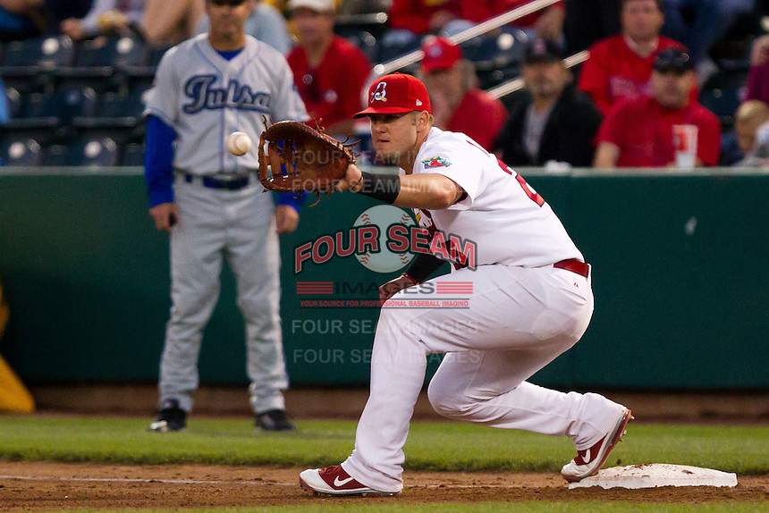 Matthew Adams (25) of the Springfield Cardinals catches a ball thrown to first base during a game against the Tulsa Drillers on April 29, 2011 at Hammons Field in Springfield, Missouri.  Photo By David Welker/Four Seam Images.
