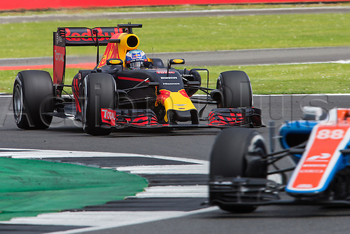 10.07.2016. Silverstone, England. Formula One British Grand Prix, race day.  Red Bull Racing driver Daniel Ricciardo about to lap Manor Racing MRT driver Rio Haryanto.