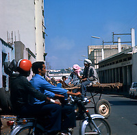 Motor bicycle and horse and cart. Cassablanca,Morocco 1975