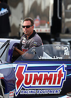 Apr 10, 2015; Las Vegas, NV, USA; NHRA pro stock driver Jason Line being towed on the return road during qualifying for the Summitracing.com Nationals at The Strip at Las Vegas Motor Speedway. Mandatory Credit: Mark J. Rebilas-