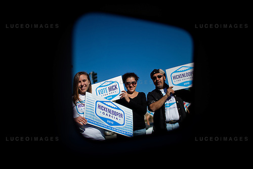 Supporters of Democratic candidate John Hickenlooper for governor of Colorado hold signs on a Denver streetcorner.  (Left to right) Mikaela Larson, Pilar Chapa, and Mike Roque...GENERAL CAPTION: People and scenes from Colorado Election Day, 2010.  Colorado is home to several hotly contested seats, including a close Senate Race and several house seats...Assigning Editor: Michael Wichita AARP Bulletin.Contract #: 5032.Model Released: Yes.AARP Restrictions: No (Limited to Contract).