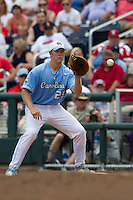 North Carolina first baseman Cody Stubbs (25) records a putout at first base during Game 3 of the 2013 Men's College World Series against the North Carolina State Wolfpack at TD Ameritrade Park on June 16, 2013 in Omaha, Nebraska. The Wolfpack defeated the Tar Heels 8-1. (Andrew Woolley/Four Seam Images)