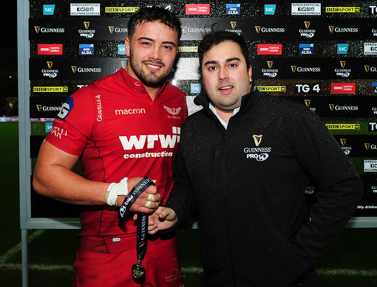 Scarlets' Josh Macleod is presented with the man of the match award by Sam Harries<br /> <br /> Photographer Kevin Barnes/CameraSport<br /> <br /> Guinness Pro14 Round 11 - Scarlets v Ospreys - Tuesday 26th December 2017 - Parc y Scarlets - Llanelli<br /> <br /> World Copyright &copy; 2017 CameraSport. All rights reserved. 43 Linden Ave. Countesthorpe. Leicester. England. LE8 5PG - Tel: +44 (0) 116 277 4147 - admin@camerasport.com - www.camerasport.com