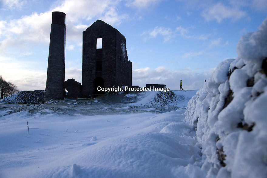 13/01/17<br />  <br /> After heavy snow overnight, Carolyn Bointon, explores the ruins of Magpie Mine in the Derbyshire Peak District near Bakewell. <br /> <br /> All Rights Reserved F Stop Press Ltd. (0)1773 550665   www.fstoppress.com