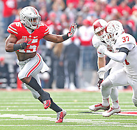 Ohio State Buckeyes running back Ezekiel Elliott (15) strikes a familiar pose as he tries to fend of Indiana's Indiana Hoosiers safety Mark Murphy (37) in the first half at Ohio Stadium on 22, 2014. (Chris Russell/Dispatch Photo)