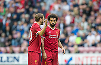 New signing Mohamed Salah of Liverpool chats with Adam Lallana of Liverpool during the pre season friendly match between Wigan Athletic and Liverpool at the DW Stadium, Wigan, England on 14 July 2017. Photo by Andy Rowland.