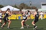 Santa Barbara, CA 02/18/12 - Elizabeth Fennie  (Cal Poly SLO #9), Sarah Shea (Colorado #9) and Sarah Lautman (Colorado #13) in action during the 2012 Santa Barbara Shootout.  Colorado defeated Cal Poly SLO 8-7.