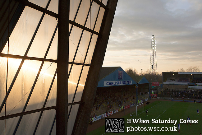 Carlisle United 1 Accrington Stanley 0, 15/11/2014. Brunton Park, League Two. The sun setting over the Warwick Road stand during the English League Two match between Carlisle United (in blue) and visitors Accrington Stanley at Brunton Park. The match was won by the home team by one goal to nil, the winner scored by Derek Asamoah in the 21st minute. The match was watched by 4,069 spectators. Photo by Colin McPherson.