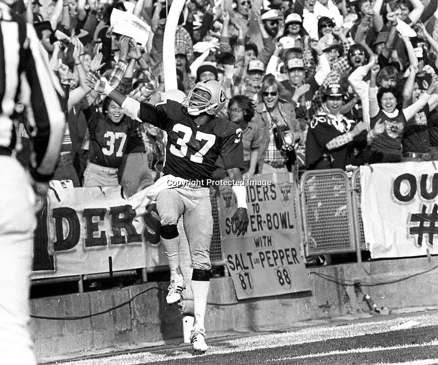 Oakland Raider Lester Hayes celebrates after interception TD..(1979 photo/Ron Riesterer)