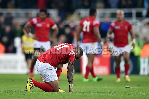Fetu'u Vainikolo of Tonga takes a moment to himself after the match. Rugby World Cup Pool C match between New Zealand and Tonga on October 9, 2015 at St James' Park in Newcastle, England. Photo by: Patrick Khachfe / Onside Images