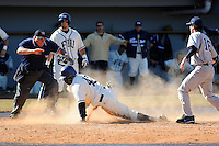 28 February 2010:  FIU's Lammar Guy (42) slides safely into home on a passed ball in the seventh inning as the FIU Golden Panthers defeated the Oral Roberts Golden Eagles, 7-6 (10 innings), at University Park Stadium in Miami, Florida.