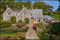 BNPS.co.uk (01202 558833)<br /> Pic: Stags/BNPS<br /> <br /> Fans of the Famous Five can follow in Julian, Dick, George, Anne and Timmy the dog's footsteps and create their own jolly japes with this idyllic coastal home.<br /> <br /> Widmouth House is perfect for Enid Blyton-style escapism, in a magical location on the north Devon coast with its own private beach, which was used as a filming location for a TV adaptation of one of the books.<br /> <br /> The stunning property, which is on the market with Stags for &pound;2.9million, also has 33 acres of headland and woodland and it's own hamlet of 11 holiday cottages, providing a ready-made business for anyone who wants to swap the rat race for a rural adventure.