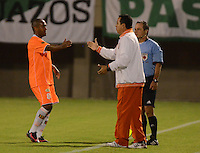 ENVIGADO -COLOMBIA-19-02-2014. Neider Morantes (Izq) jugador y Juan Carlos Sanchez (Der) de Envigado FC celebran un gol en contra de Atlético Nacional durante partido por la fecha 6 de la Liga Postobón I 2014 realizado en el Polideportivo Sur de la ciudad de Envigado./ Neider Morantes (L) player and Juan Carlos Sanchez coach of Envigado FC celebrate a goal against Atletico Nacional during match for the 6th date of the Postobon League I 2014 at Polideportivo Sur in Envigado city.  Photo: VizzorImage/Luis Ríos/STR