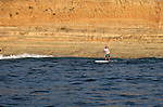 LA JOLLA, CA - FEBRUARY 28:  Waterman George Plsek paddles on his stand-up paddleboards (SUP) in front of Torrey Pines State Reserve on February 28, 2012 in La Jolla, California. (Photo by Donald Miralle)