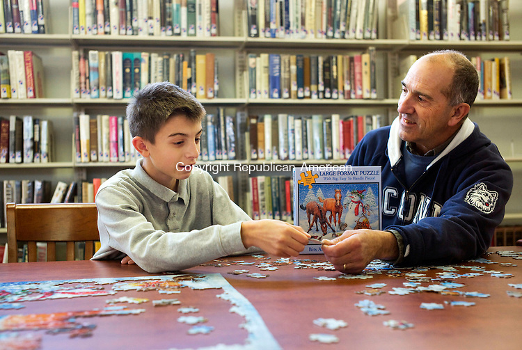Middlebury, CT- 25 November 2015-112515CM02-  Nathaniel Zembruski, 12, left, of Naugatuck and his grandfather Nick Corsi of Middlebury,  work on a puzzle at the Middlebury Public library on Tuesday.  A calendar of events for the month of December is available at the library.  For more information stop by the library located at 30 Crest Road or contact them by phone at 203-758-2634. Christopher Massa Republican-American