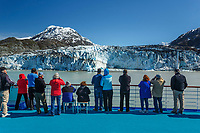 Visitors aboard Pacific Princess Cruise ship view Lamplugh Glacier in Johns Hopkins Inlet with Fairweather Mountains in Glacier Bay National Park in Southeast, Alaska     No Model Releases<br /> <br /> (C) Jeff Schultz/SchultzPhoto.com