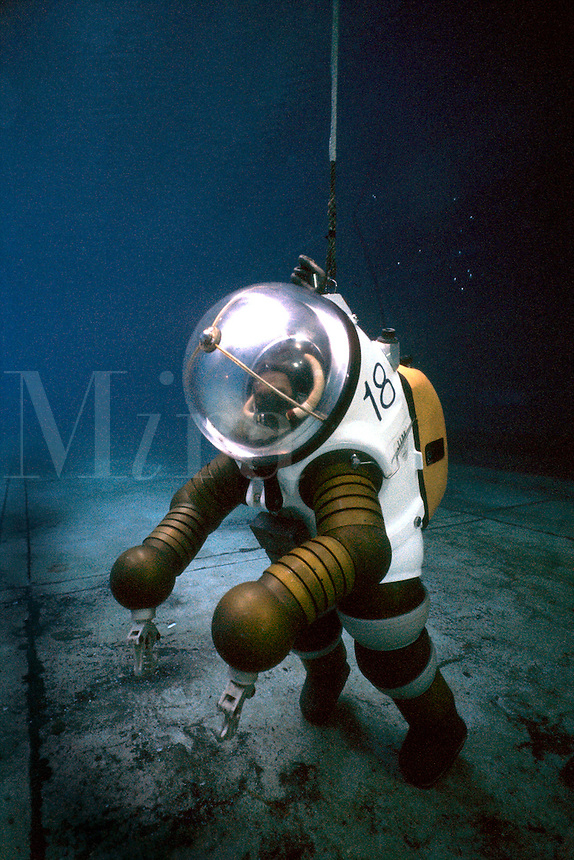 .professional deep sea diver in armoured suit. MR