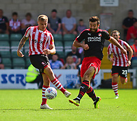 Lincoln City's Harry Anderson vies for possession with Swindon Town's Michael Doughty<br /> <br /> Photographer Andrew Vaughan/CameraSport<br /> <br /> The EFL Sky Bet League Two - Lincoln City v Swindon Town - Saturday August 11th 2018 - Sincil Bank - Lincoln<br /> <br /> World Copyright &copy; 2018 CameraSport. All rights reserved. 43 Linden Ave. Countesthorpe. Leicester. England. LE8 5PG - Tel: +44 (0) 116 277 4147 - admin@camerasport.com - www.camerasport.com