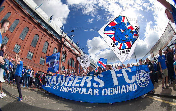 Rangers fans march together before kick off to mark the return of Scotland's most successful clun to the top flight after four years in the wilderness